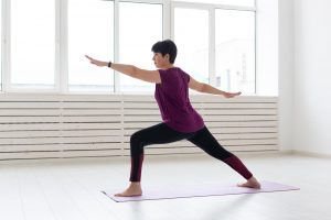 doing yoga 300x200 - People, Yoga, Sport And Healthcare Concept - Middle-aged Woman S